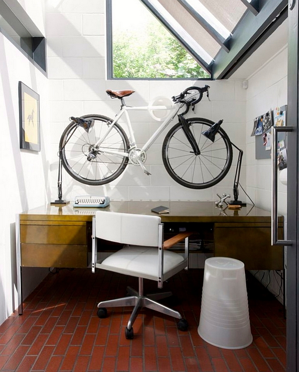 Compact-home-office-with-a-wall-mounted-bike-above-the-desk